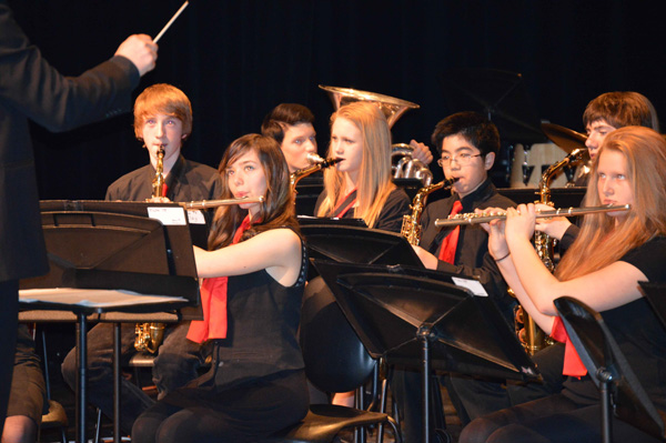 Members of the Grade 8 band watch conductor Jim Redding's baton. Andy Pfeiffer photo