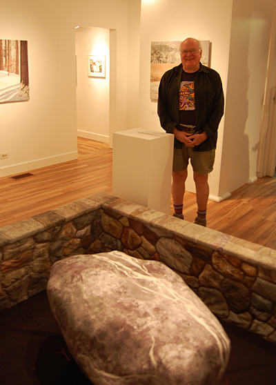 Vancouver potter Bob Kingsmill, who is in Revelstoke to conduct a workshop for would-be ceramicists, admires Beverly Reid's clever installation, Homage to a Rock.  If you are interested in attending Bob's workshop at the Visual Arts Centre on Sunday starting at 9:45 am please contact Sandra Flood at 250-837-???? David F. Rooney photo