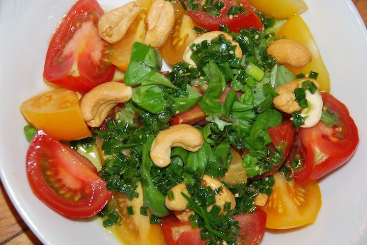 The tomato basil salad gets drizzle of chive vinaigrette.