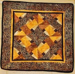 Chinese Puzzle, pieced and quilted by Bev Weige.