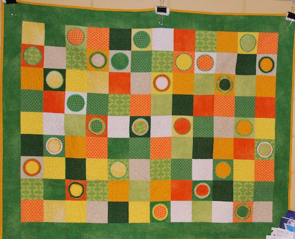 Citrus Lollipops. By Guild members, machine quilted by Linda Walford.