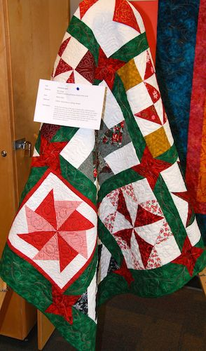 Christmas Quilt by Bev Weige. Machine quilted by friends of the Guild.