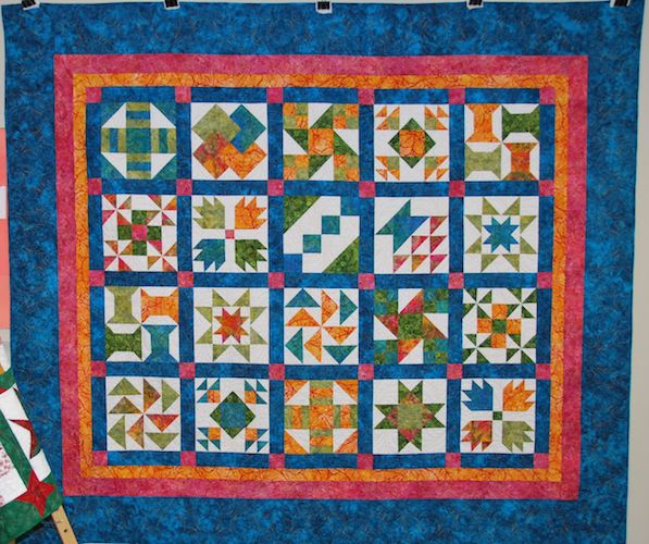 Queen Size Sampler Quilt by Wnedy Topping, quilted by Linda Walford.