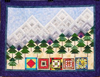 Quilting at Sisters. Pieced by Jill Leslie. Machine quilted by Chris Leithwood.