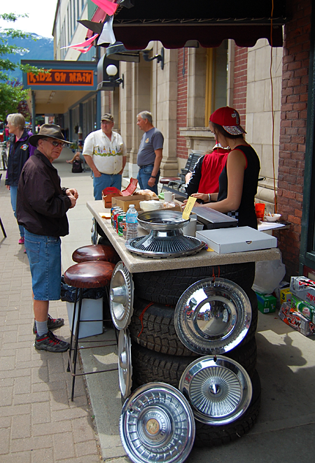The girls at Conversations set up shop outside the cafe to tempt the passing crowds. David F. Rooney photo