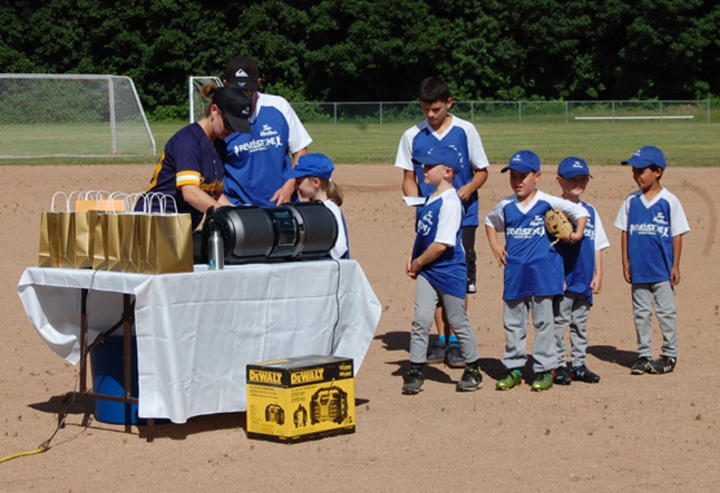 These are the members of one of the older kids' teams, Rally Cap Blue with coaches Shawn Bracken and Oliver Corley. David F. Rooney photo