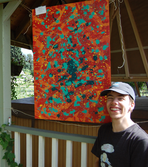Madison Hutchinson poses with one of paintings on display in Karilyn's garden. David F. Rooney photo