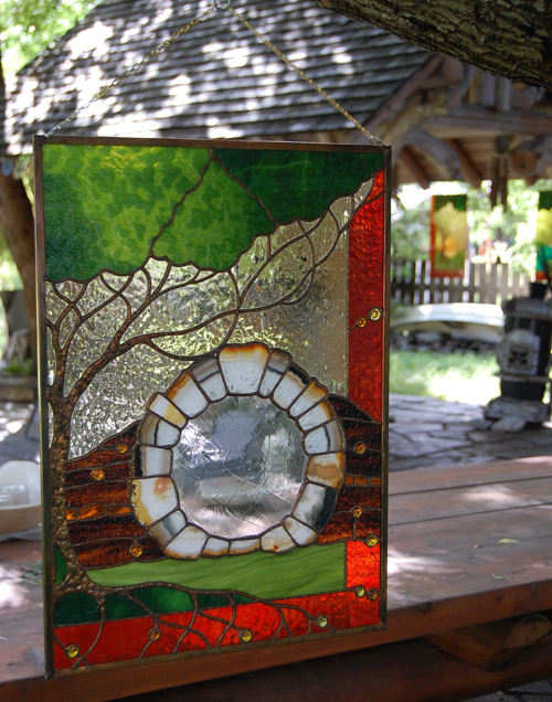 Geordie Knoess has a growing reputation as a stained-glass worker, which he clearly displayed in the garden of the Oscar Street home he shares with painter Barbara Maye. David F. Rooney photo