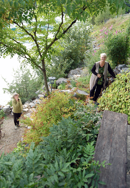 The last garden on the tour was Diane Martin's remarkable and very Zen-like rock garden. Here Diane (left) and Sharon Kelley suggest that I take a different route from the yard proper down the rock face she created with regular deliveries of rock by her sons. David F. Rooney photo