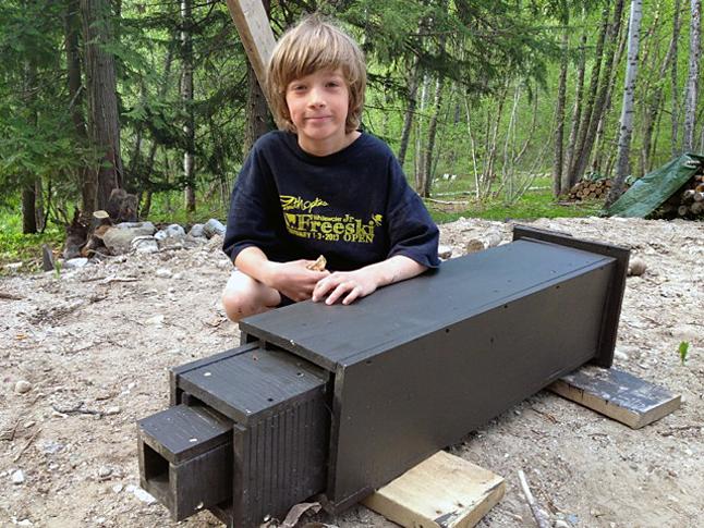 Local resident, Saxon Bowick, builds a bat-house for his property. Erica Konrad photo courtesy of the Kootdenay Bat Project