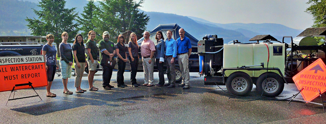 In photo left to right: Jennifer Vogel, Executive Director, Central Kootenay Invasive Species Society; Khaylish Fraser, Aquatic Invasive Species Program Coordinator, Central Kootenay Invasive Species Society; Robyn Hooper, Program Manager, Columbia Shuswap Invasive Species Society; Allana Oestreich and Randy Harris,  Board members, East Kootenay Invasive Plant Council; Sheila Street, Environment Program Lead, FortisBC; Ember Heidt, Compliance and Enforcement Officer with the Conservation Officer Service; Bill Bennett, MLA Kootenay East; Krista Watts, Environmental Manager, Columbia Power Corporation; Tim Hicks, Manager, Water and Environment, Columbia Basin Trust and Greg Deck, Chair, Columbia Basin Trust. Photo courtesy of the Columbia Basin Trust