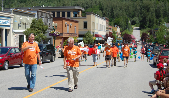 Local New Democrats paraded behind MLA Norm Macdonald (left) and Wayne Stetski, the former Cranbrook mayor who is running for the party in this autumn's federal election. David F. Rooney photo