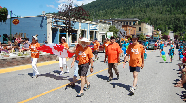 Local New Dems proudly march in matching orange T-shirts. David F. Rooney photo