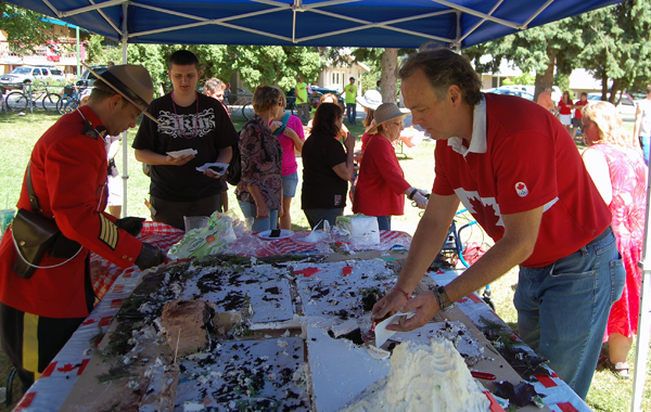 It took an hour but by about 2 pm that amazing cake was pretty well... gone. Happy Canada Day! David F. Rooney photo