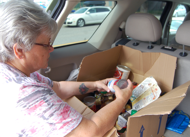No one wants to throw out food, but expired food items and even packahged foods that have been opened and partially used are of absolutely no use to the Food Bank, says Community Connections' Outreach Manager Patti Larson. David F. Rooney photo