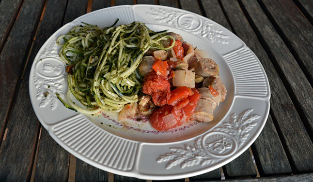 This sausage stew was cooked within three hours. It is accompanied by a raw spiralized zucchini dish covered with pesto, walnuts and grated parmesan cheese.Spiralizers, which make spaghetti-like strings from raw vegetables, are an excellent manual tool for off-the-grid cooking.  Laura Stovel photo