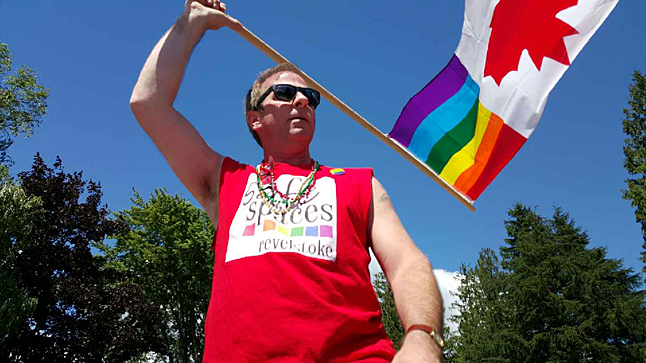 "Colby Morin, who ran the sound system for the Safe Spaces parade entry, snapped a few candid shots with this cell phone, including this image of Safe Spaces Society Chairman Martin Ralph. ""Several people in the group captioned this picture ""Rainbow Warrior"" because they said I looked so proud and strong and happy, which I was, of course,"" Martin told The Current. ""I am so pleased and incredibly proud of this first outing ventured by the Safe Spaces Society, and all of our friends, family, allies and many supporters! A huge thank you to everyone who came out to walk, and much thanks to all those who helped to make the parade event a great success and so much fun for everyone! Even the crowds watching the parade got into the fun and danced to our music with cheers of support! Such a wonderful thing to see the community of Revelstoke supporting Safe Spaces Revelstoke, and the LGBTQ2S community at large! ""Special thanks to Mayor Mark McKee and Councilor Gary Sulz who walked and danced with our group! And to Alan Chell and Mike Hooker from the School District for joining us as well! I know they all had a great time out there!"" Colby Morin photo"