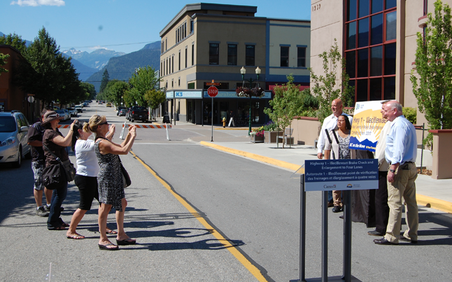 At the conclusion of the 16-minute announcement at Revelstoke City Hall of the participants lined up and posed for the near-compulsory political photo op. All the aides taking the pictures needed was a little handshaking and we could have called it a  grin-and-grin. David F. Rooney photo