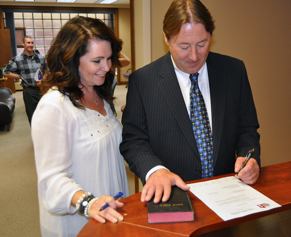 Allan Chabot (right) started his new job as Revelstoke's Chief Administrative Officer on August 17, but he was;t legal until he was sworn in by Corporate Administration Director Dawn Levesque on Friday, August 21, just before the start of a meet and greet at City Hall. David F. Rooney photo