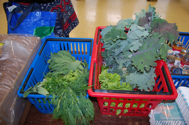 These are some of the herbs and produce gathered on Thursday evening and put out for selection by Food Bank clients on Friday morning. The Food Bank opened its doors at 8:30 am and by 9 am all of the Local Food Initiative vegetables were snapped up. David F. Rooney photo
