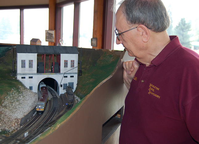 Doug watches a train emerging from the diorama's Connaught Tunnel, which was also one of Patrick Lawes' creations. David F. Rooney photo