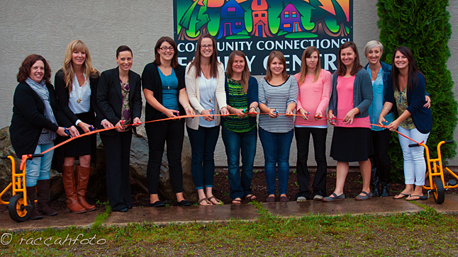 Members of the Community Connections  Family Services team pose at the ribbon cutting ceremony during the August 31 opening of the Family Centre at the Alliance Church on Illecillewaet Road. From left to right are Andree Rioux, Kelly Silzer, Gorette Imm, Erin MacLachlan, Sheena Bell, Lindsay Legebokoff, Kaitlin Larson, Christina Chamberlain, Amanda MacIntosh, Stacy Sanchez and Karley Trauzzi. Amanda Raccah photo courtesy of Community Connections