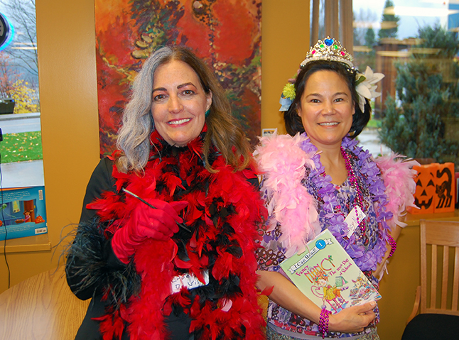 Drop in to the public library and you were as likely to be helped by Cruel Deville as by Fancy Nancy! Excellent outfits ladies! David F. Rooney photo
