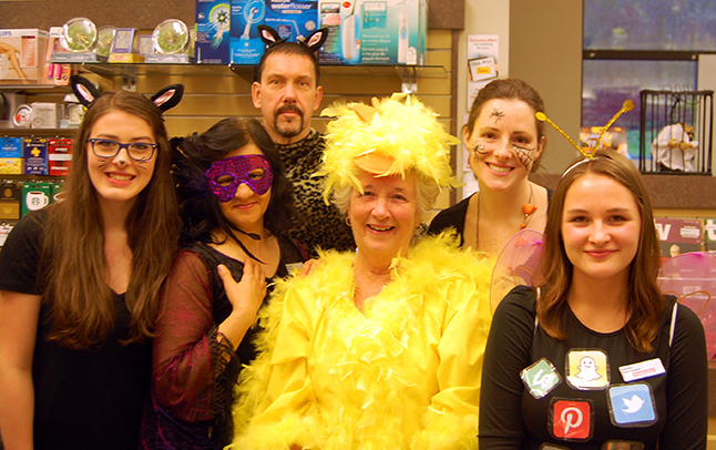 The gang at Pharmasave always has fun dressing up and — Look! — there's another chi... well a yellow bird of some kind, probably a canary. Happy Halloween, Revelstoke! David F. Rooney photo