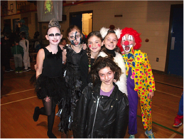 Here are Rylee Rosenberger, Lauryn Kline, Aislin Buchanan, Mimi Kramer, Maeve MacLeod and Ava Lussier having fun at the Halloween Dance. Photo and caption by Emily MacLeod and Amelie Delesalle AHE Student Reporter-photographers