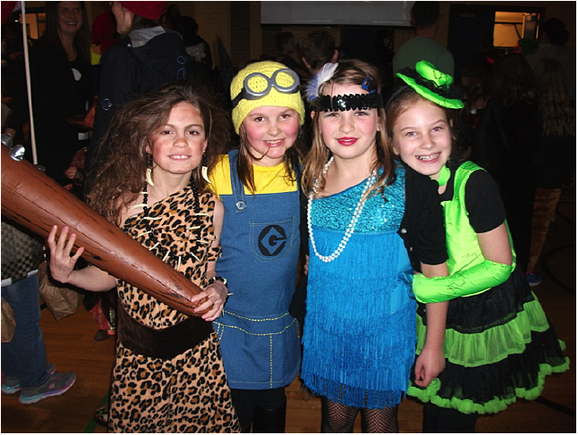 Here are Suri Stewardson, Emma Mair, Natalia Morrone and Krystina Portras striking some fun poses at the Halloween Dance. Photo and caption by Emily MacLeod and Amelie Delesalle AHE Student Reporter-photographers
