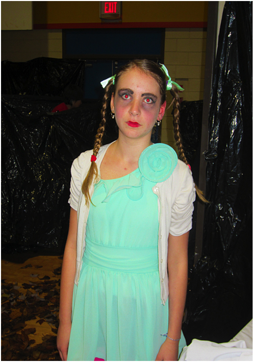 Arianna Moronne is dressed as an innocent little girl but she is much deadlier then she looks. Photo and caption by Emily MacLeod and Amelie Delesalle AHE student reporter-photographers
