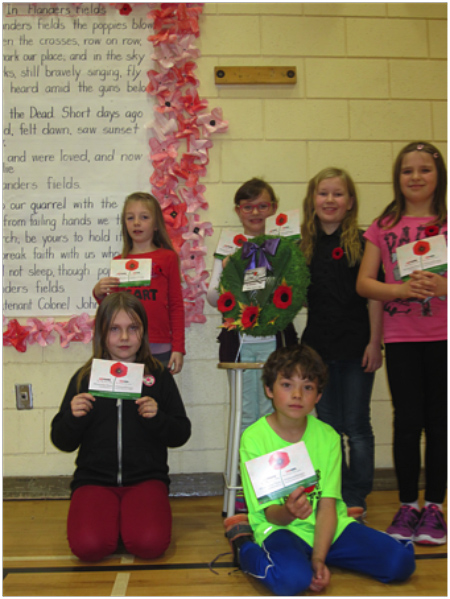 Here are some of Mrs. Thompson's Grade 3/4 students who shared their postcards with their schoolmates on November 10 in the gym. Back row, left to right: Joey Cowley, Emma Mair, Clara Kenyon and Natalia Morrone. Front row, left to right: Adelaide Dunkerson and Cameron Norrie. Photo and caption by Emily MacLeod and Amelie Delesalle, AHE student reporters/photographers