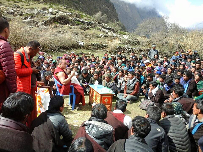 Lama Pema providing spiritual guidance in Tsum after the recent earthquake. Photo courtesy of Giles Shearing