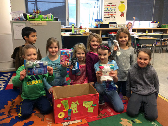 Students in Ashley Dollar's Grade 1/2 class show their donation box and some of the items donated to the pyjama drive. Eleanor Wilson photo