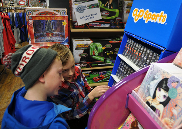 If you ever thought Moonlight madness was just for adults, a trip to Legends-n-Heroes would ave shown how wrong you were. Thomas MacDonald and his pal Donald Robichaud hit the store early in the annual shopping evening to check out the goodies on offer. David F. Rooney photo