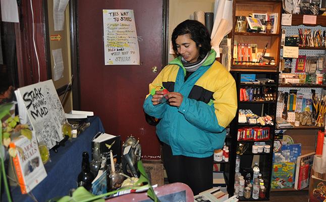 Anita Hill enjoyed poking around at Castle Joe Books. David F. Rooney photo