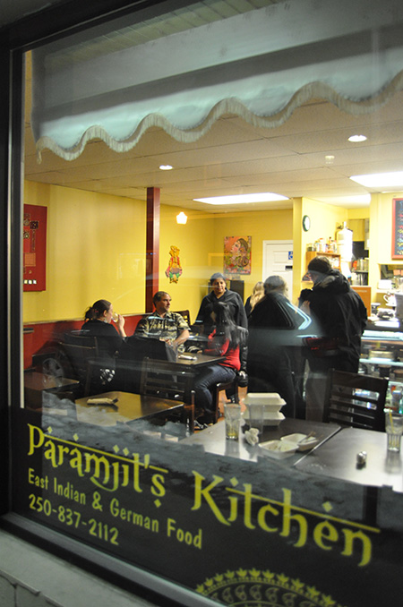 Goldie Sanghera (center) talks with some of the diners at her great little restaurant, Paramjit's Kitchen. David F. Rooney photo
