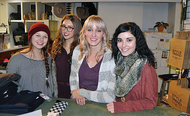 Diane Bull (centre) and her crew at Style Trend — Lainey Thur, Raighel Levesque and Chloe Speerbrecker took advantage during lull in the evening to pose for a quick photo. David F. Rooney photo