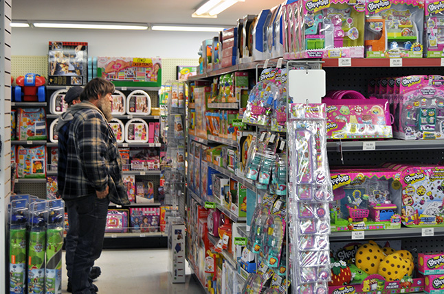 A few blocks east and north of Legends-n-Heroes other people were out toy hunting at the Big Apple. Toys and games are No surprise there!) among the most sought-after products at Christmas. David F. Rooney photo