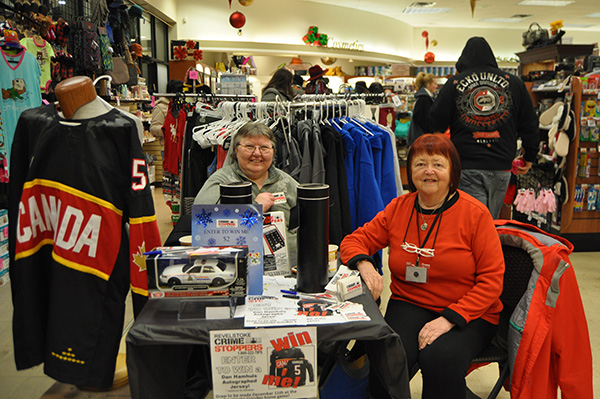 Dorothy Bouchard and Tannis Kingscote were selling tickets for the Revelstoke Crime Stoppers draw at Pharmasave. Depending on what kind of ticket you bought you could win that hockey jersey or a toy Mountie cruiser. David F. Rooney photo