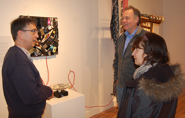 David Walker chats with MLA Norm Macdonald and his wife, Karen, about his art installation at the Visual Arts Centre. David F. Rooney photo