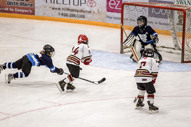 Revelstoke #14 Eldyn Pauls edges in front of a diving #5 Shanahan Gare from Vernon. Jason Portras photo