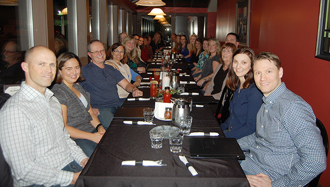 People's Drug Mart owner David Lafreniere and his wife Kim (sitting together on the left) hosted the pharmacy's annual staff party at Emo's on Saturday, November 21. I like those smiling faces! Please click on the photo to see a larger version. David F. Rooney photo