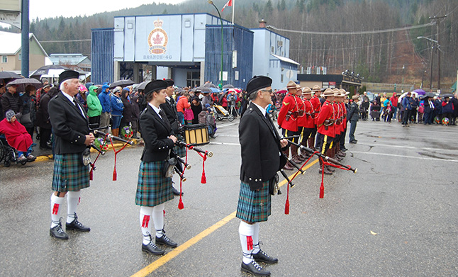 Members of the Highland Pipe Band, our local Mounties and National Park Wardens stand at ease during the annual Remembrance Day ceremony at the cenotaph. Hundreds of Revelstokians kept faith with our war dead and the veterans who fought for our nation. David F. Rooney photo