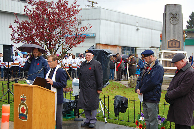Rev. Dan Meakes, the Legion's chaplain, recites a prayer. David F. Rooney photo