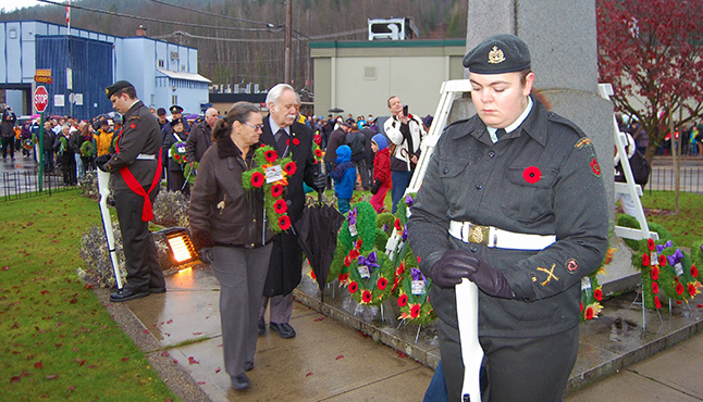 Revelstokians take the time to lay wreaths and crosses at the cenotaph in memory of their forebears who served Canada in uniform. David F. Rooney photo