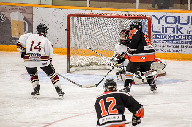 Silvertips #12 Jacob Tudan rings a zinger off the wide side post. Jason Portras photo