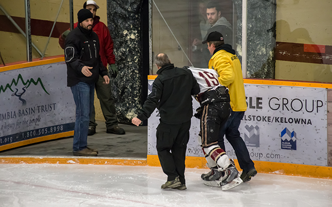 Grizzlies' #19 James LeBuke had to be helped off the ice due to an undetermined injury. Our best wishes go out to him for a speedy full recovery. Jason Portras photo