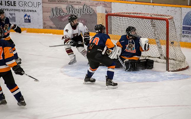 Grizzlies #14 Rory Christie-Hoyle lines one past the Rockies Goaltender Skeeter Langton. Jason Portras photo