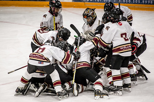 The classic pile-on after a good win. Jason Portras photo